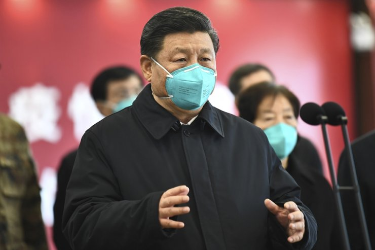 In this Tuesday, March 10, 2020, photo released by China's Xinhua News Agency, Chinese President Xi Jinping talks by video with patients and medical workers at the Huoshenshan Hospital in Wuhan in central China's Hubei Province. Xinhua via AP