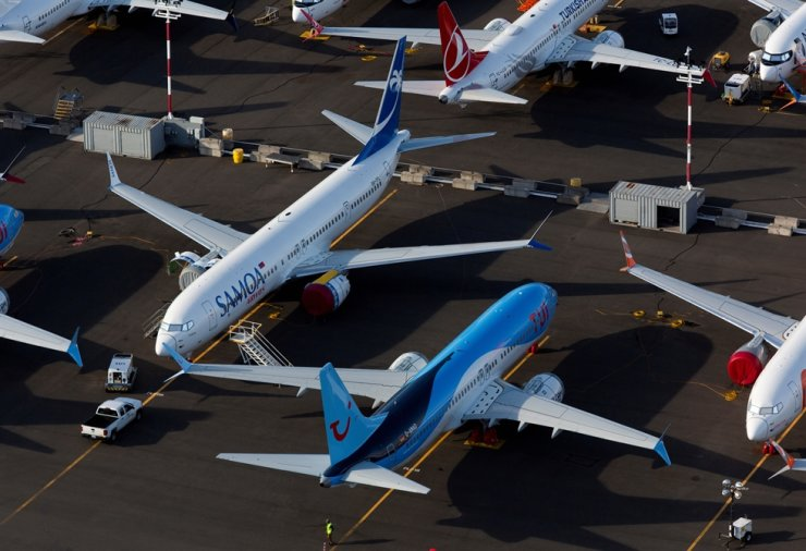 Boeing 737 Max aircraft are parked in a parking lot at Boeing Field in this aerial photo over Seattle, Washington, U.S., June 11, 2020. Reuters