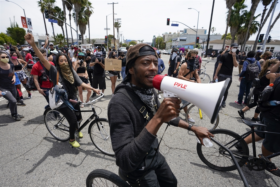 A demonstrator in the Hollywood section of Los Angeles raises his fist and shouts during a protest on Tuesday over the death of George Floyd, who died May 25 after he was restrained by Minneapolis police. (AP Photo/Ringo H.W. Chiu)