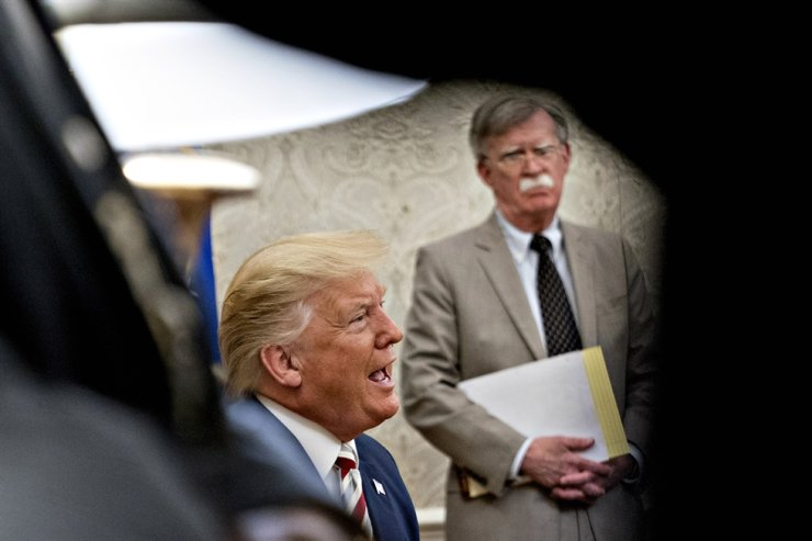 U.S. President Donald Trump speaks as John Bolton, national security advisor, listens during his meeting with Klaus Iohannis, Romania's president, not pictured, in the Oval Office of the White House in Washington, DC, Aug. 20, 2019. EPA