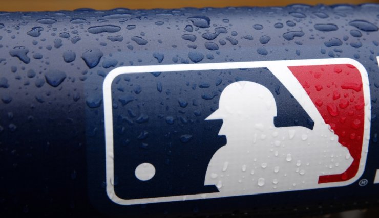 Rain drops on the Major League Baseball (MLB) logo on the railing of the dugout before game five of the American League Championship Series between Boston Red Sox and Detroit Tigers at Comerica Park in Detroit, Michigan, October 2013. According to media reports, MLB issued on 23 June a 60-game schedule that should start between July 23 and 24 July. / EPA-Yonhap
