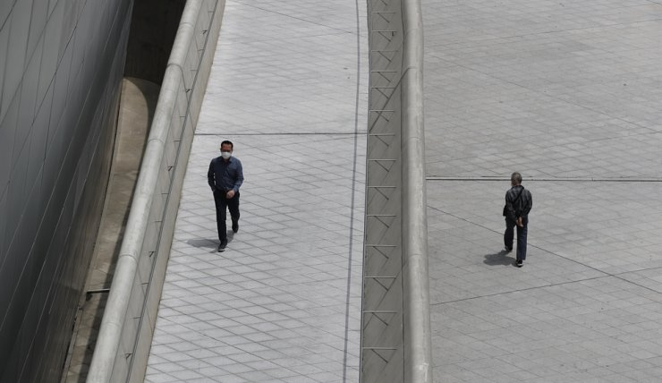 Visitors wearing face masks walk at the Dongdaemun Design Plaza in Seoul, Wednesday, June 3, 2020. AP