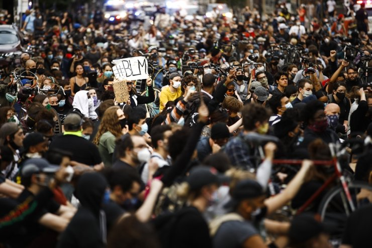 In this June 2, 2020, file photo, demonstrators sit in silence for nine minutes in Philadelphia during a protest over the death of George Floyd, who died May 25 after he was restrained by Minneapolis police. AP