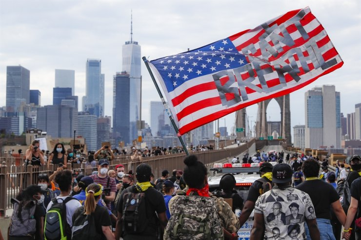 Protesters march on the Brooklyn Bridge after a rally in Cadman Plaza Park, Thursday, June 4, 2020, in New York. AP