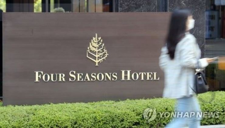 A man working at the men's sauna at the Four Seasons Hotel in Gwanghwamun, central Seoul, has tested positive to coronavirus. Yonhap