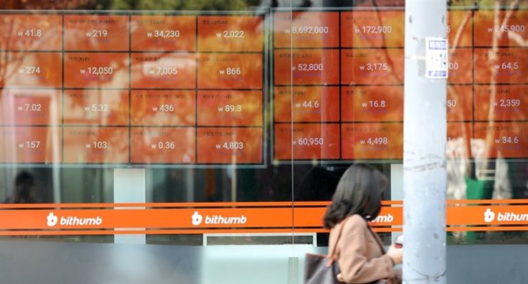 A pedestrian passes by an office of the nation's largest cryptocurrency exchange, Bithumb, in Seoul in this file photo taken on Dec. 8, 2019. Yonhap