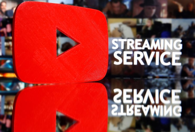 A 3D-printed YouTube logo is seen in front of displayed 'Streaming service' words in this illustration taken March 24, 2020. Reuters