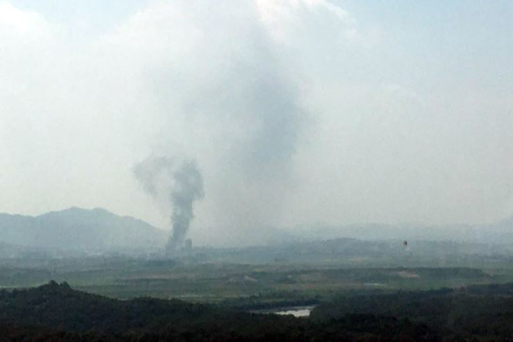 Smoke rises from the Gaeseong Industrial Complex, Tuesday. The South Korean Ministry of Unification said North Korea blew up the South-North joint liaison office, located in the complex, at 2:49 p.m., three days after Kim Yo-jong, North Korean leader Kim Jong-un's sister, warned that the office would 'completely collapse.' Yonhap