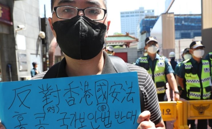 An activist stages a protest against Chinese legislature's approval on national security laws for Hong Kong in front of the Chinese embassy in Seoul, Monday. Yonhap