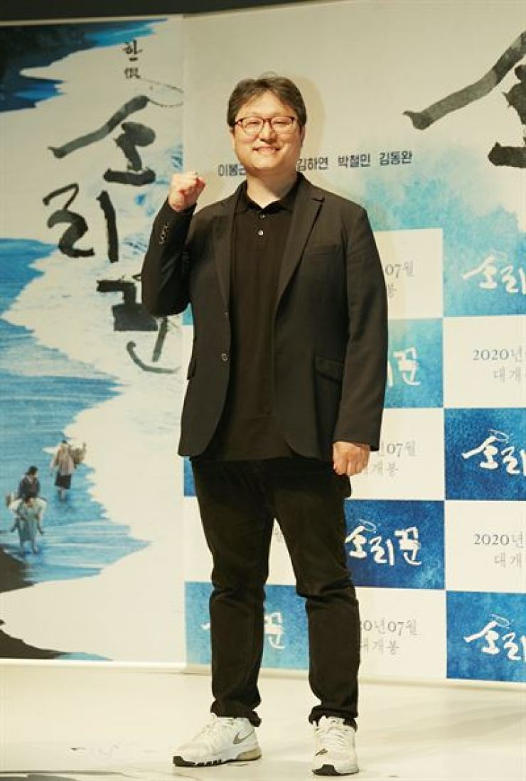 Director Cho Jung-rae poses for a photo during a press conference for the film 'The Singer' in Seoul, Monday. Courtesy of Little Big Pictures
