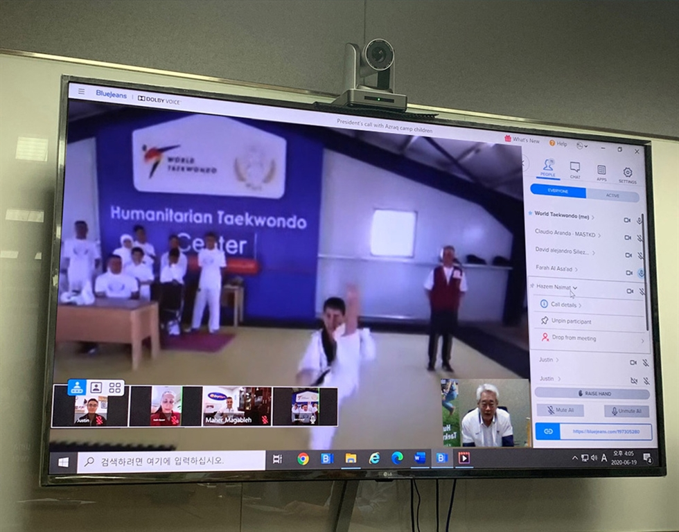 World Taekwondo President Choue Chung-won smiles during a video call ― from his office in Seoul ― with young athletes at the Azraq Refugee Camp in Jordan, June 19. Courtesy of World Taekwondo