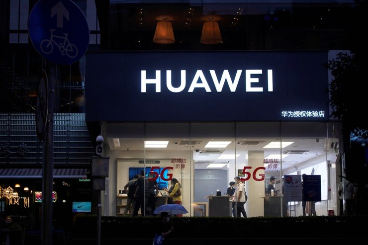 People are seen in a Huawei shop on a street in Shanghai, China, June 18, 2020. Reuters
