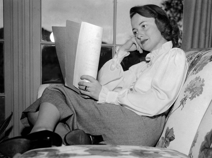 In this April 16, 1948, file photo, actress Olivia DeHavilland reads a script. Havilland, Oscar-winning actress has died, aged 104 in Paris, her publicist said on July 26, 2020. AP