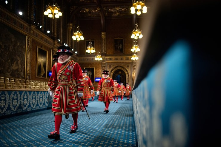 Beefeaters walk through the Royal Gallery before Queen Elizabeth II delivers the Queen's Speech during the State Opening of Parliament at the Palace of Westminster in London, Britain Dec. 19, 2019. /Reuters