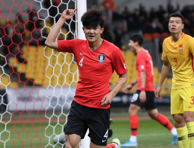 South Korean center-half Kim Min-jae celebrates after scoring a header against China during the 2019 East Asian Cup game at the Busan Asiad Stadium, Dec. 15, 2019. / Yonhap