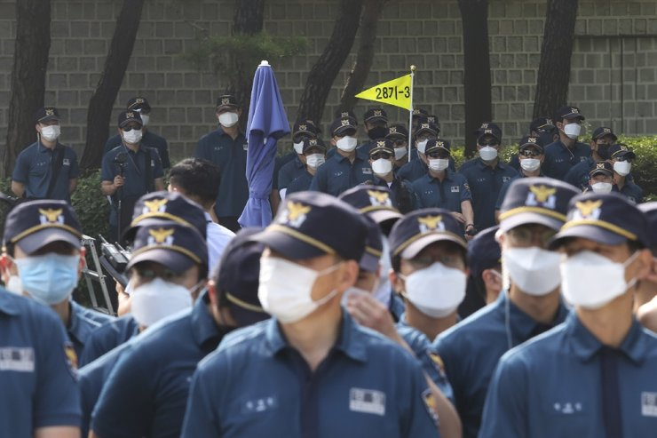 Police officers wearing face masks to help protect against the spread of the new coronavirus stand guard near the presidential Blue House in Seoul, Thursday, July 9, 2020. AP