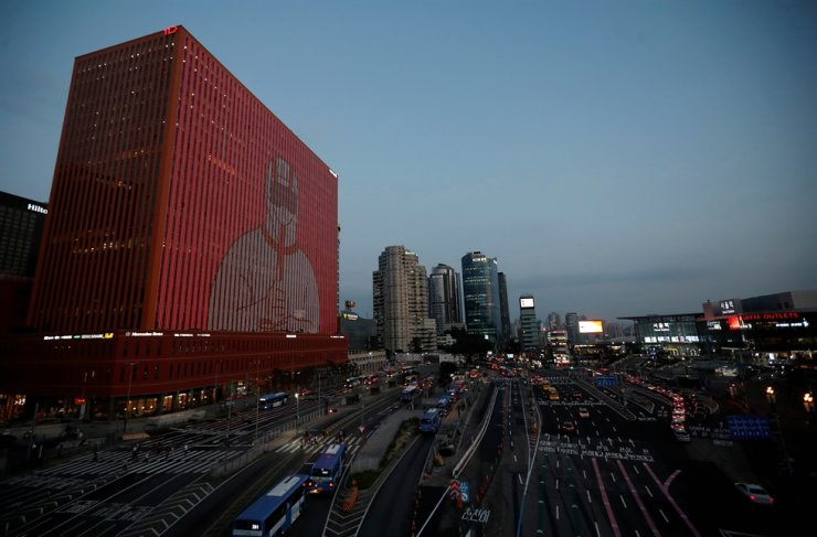 The exterior of a building is illuminated showing messages to support the country, as measures to avoid the spread of the coronavirus disease (COVID-19) continue, in Seoul, July 7, 2020. Reuters