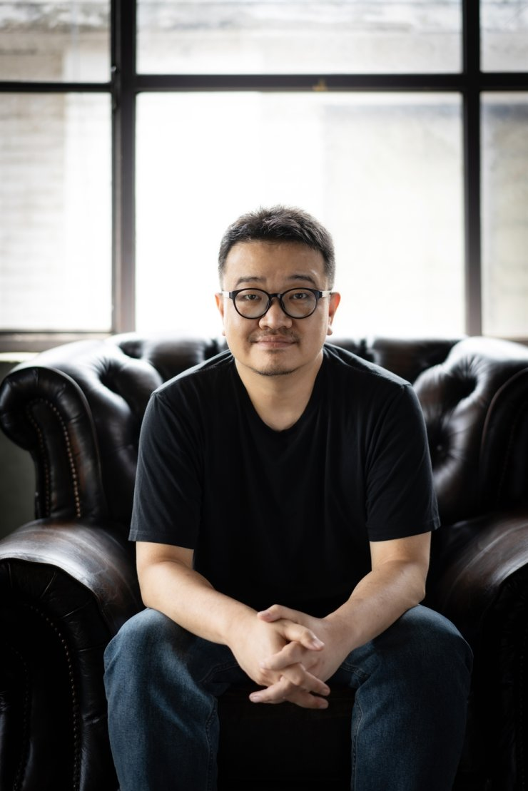 Director Yeon Sang-ho poses before an interview with The Korea Times at a cafe in Seoul, Tuesday. / Courtesy of NEW