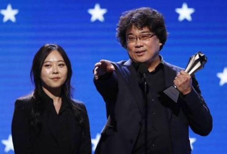 Director Bong Joon-ho, right, and Sharon Choi