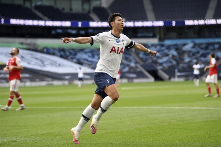 Tottenham's Son Heung-min celebrates after scoring his side's first goal during the English Premier League soccer match between Tottenham Hotspur and Arsenal at the Tottenham Hotspur Stadium in London, England, Sunday, July 12, 2020. (Michael Regan/Pool via AP)