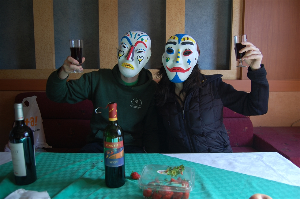 A masked bartender serves guests at the abandoned Seoul Hotel, March 2008. / Courtesy of Ron Bandun
