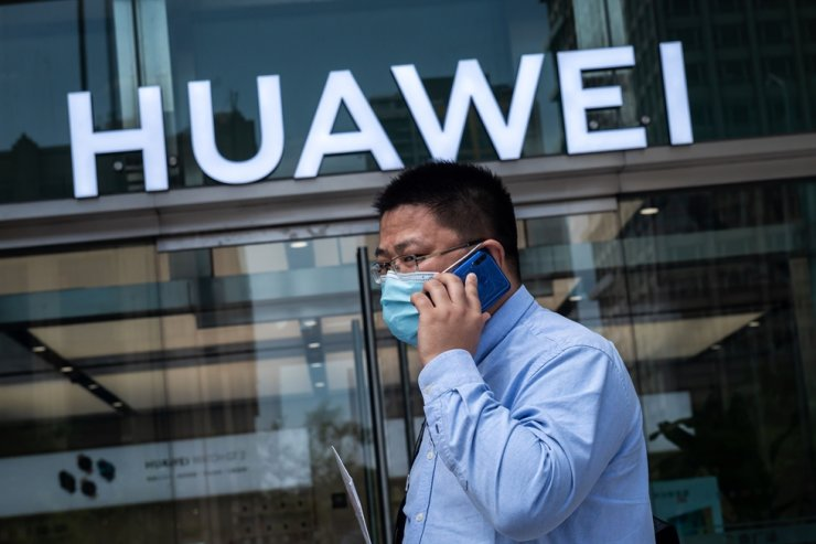 A man walks past a shop for Chinese telecoms giant Huawei in Beijing, China, May 25, 2020. AFP