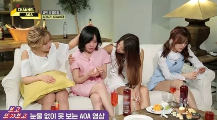 In a scene from tvN's 'Channel AOA' from 2019, Jimin, far right, seems disinterested in Mina, second from left, as she recollects her stressful moment from K-pop career.