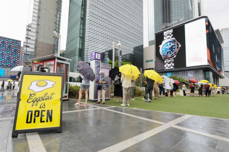 People wait in a line in front of Eggslut restaurant in COEX mall, Seoul, last Friday, upon its very first store launch in the country. / Courtesy of SPC Group