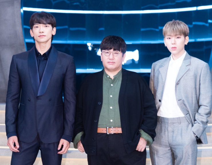 Big Hit Entertainment CEO Bang Si-hyuk, center, poses with pop star Rain, left, and rapper Ziko, during the press conference for Mnet's new survival reality show 'I-Land' at CJ ENM's headquarters in Mapo-gu, western Seoul, on June 25. / Courtesy of CJ ENM