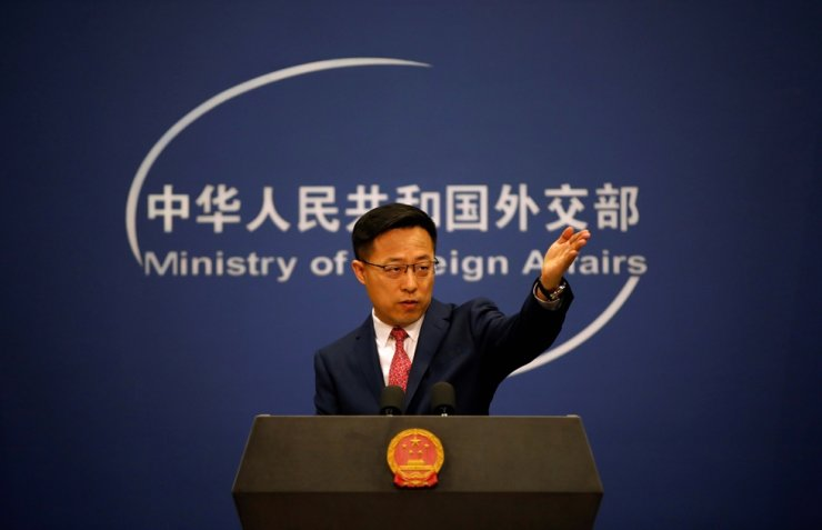 Chinese Foreign Ministry spokesman Zhao Lijian attends a news conference in Beijing, April 8, 2020. Reuters