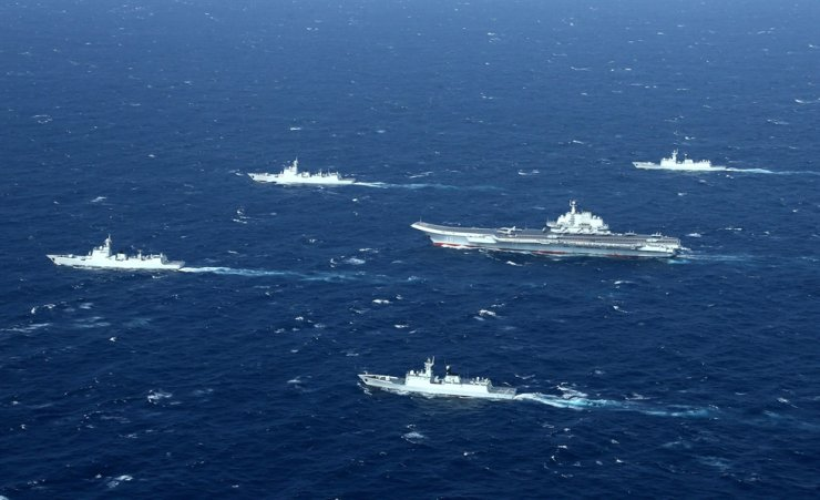 This aerial file photo shows a Chinese Navy formation, including the aircraft carrier Liaoning, center, during military drills in the South China Sea. AFP