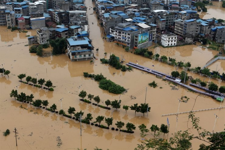 Buildings are seen in a flooded part of Liuzhou city, Guangxi region, China, 11 July 2020. Guangxi region is one of the worst affected by flood regions in China with hundreds of thousands of people displaced. /EPA
