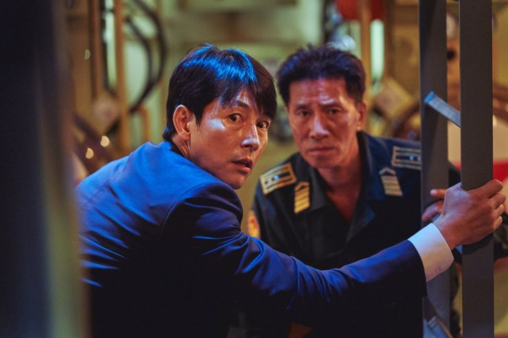 Jung Woo-sung, left, and Shin Jung-geun in a scene from the film 'Steel Rain 2: Summit' / Courtesy of Lotte Entertainment