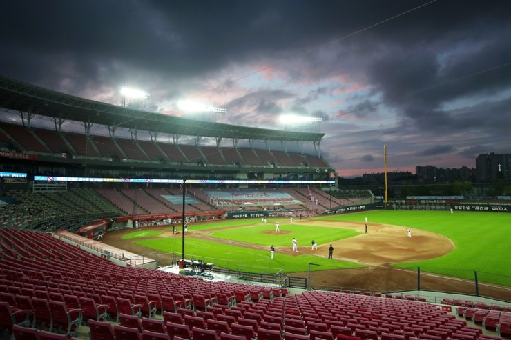 A professional baseball game between KT Wiz and the Kia Tigers is held without spectators in the southwestern city of Gwangju, Thursday, amid stricter social distancing guidelines. Yonhap