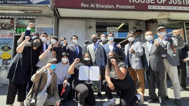 Korean American Association of Greater New York (KAAGNY) President Charles Yoon with blue tie, center, and Rev. Al Sharpton pose with Korean American community leaders and members of the National Action Network in New York on June 13. / Courtesy of KAAGNY