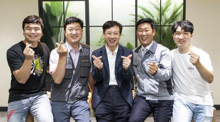 Samsung Electronics partner company employees pose for a picture at the tech giant's semiconductor plant in Hwaseong, Gyeonggi Province. Courtesy of Samsung Electronics
