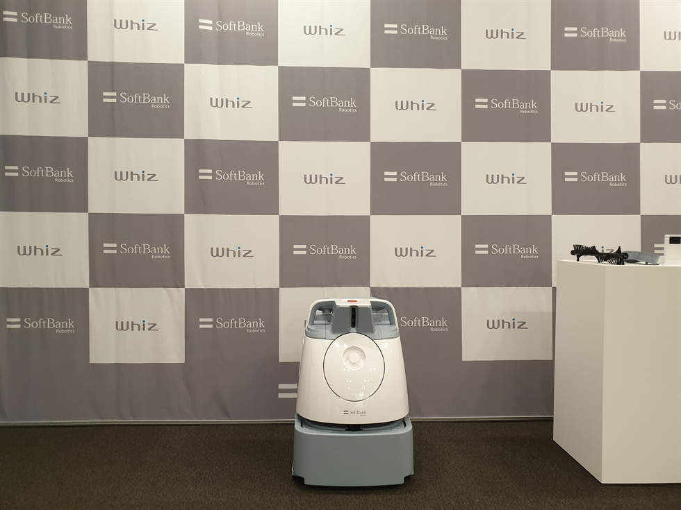 A SoftBank Robotics official introduces the company's Whiz robot vacuum during a press conference in Seoul, Tuesday. / Korea Times photo by Baek Byung-yeul