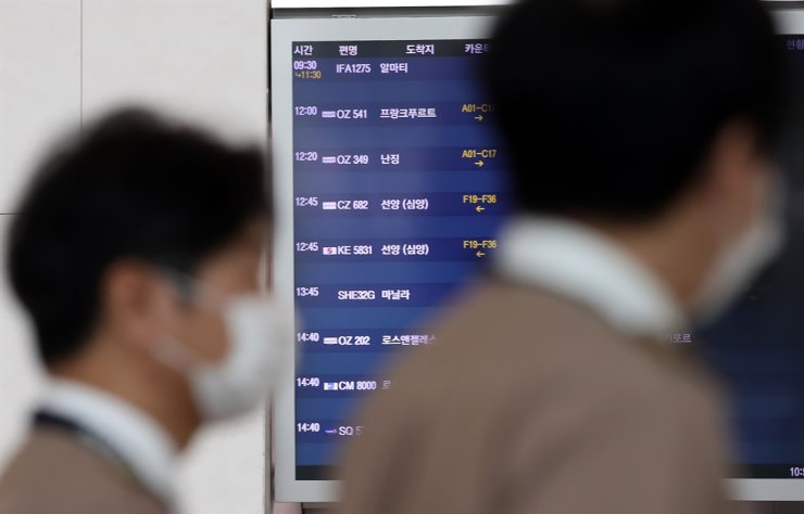 An electronic departure board at Incheon International Airport shows the schedule for the Incheon-Nanjing route, Sunday, as Asiana Airlines resumed its service the same day. / Yonhap