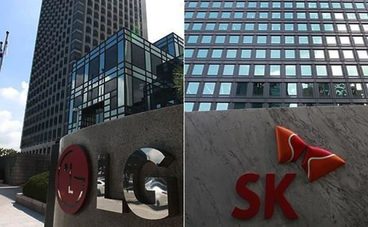 The headquarters of LG Chem, left, and SK Innovation in Seoul / Yonhap