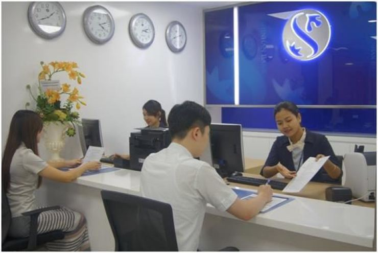 Staff of Shinhan Bank's branch in Yangon, Myanmar, address customers in this photo provided by Shinhan Bank. / Courtesy of Shinhan Bank