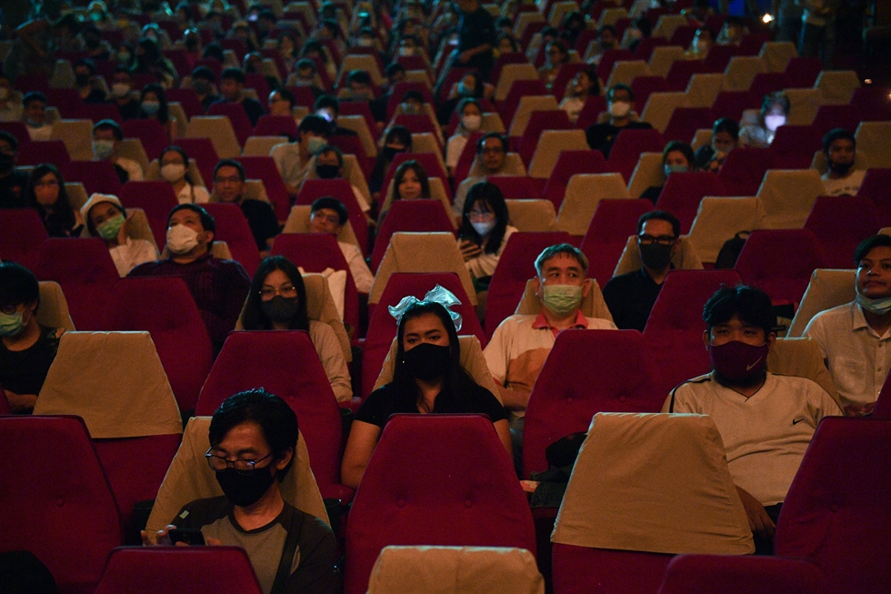 Movie fans gather to bid farewell to the last stand-alone movie theatre 'La Scala' amid the spread of the coronavirus disease (COVID-19) in Bangkok, Thailand July 4, 2020. REUTERS