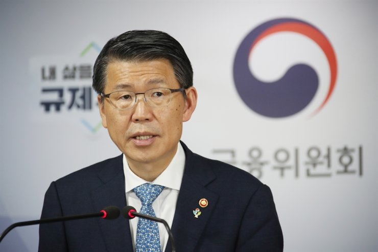 Financial Services Commission Chairman Eun Sung-soo speaks in a briefing on financial policies for the latter half of the year at the Seoul Government Complex, June 11. Yonhap