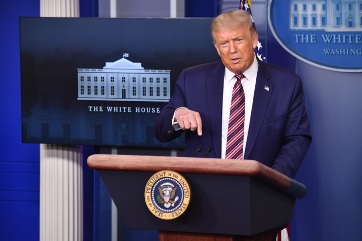 US President Donald Trump answers questions during a news conference in the Brady Briefing Room of the White House in Washington, DC, on August 12, 2020. AFP
