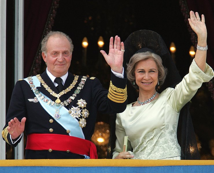 Juan Carlos of Spain and his wife Queen Sofia of Spain salute the crowd from the balcony of the Oriental Palace in Madrid, in this 2004 file photo. AFP