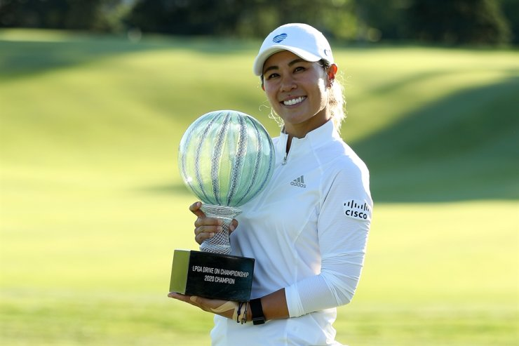 Danielle Kang celebrates with the trophy on the 18th green after her -7 under par final round victory in the LPGA Drive On Championship at Inverness Club on Sunday in Toledo, Ohio. / AFP-Yonhap
