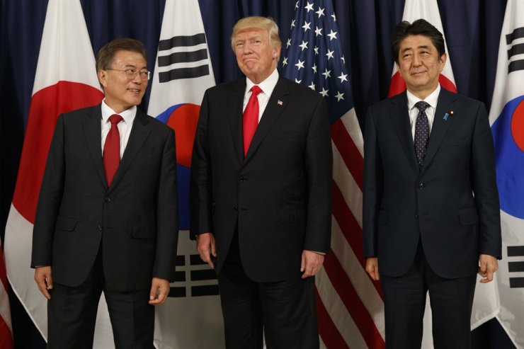 U.S. President Donald Trump, center, with South Korean President Moon Jae-in, left, and Japanese Prime Minister Shinzo Abe before a Northeast Asia Security dinner at the U.S. Consulate General in Hamburg. AP