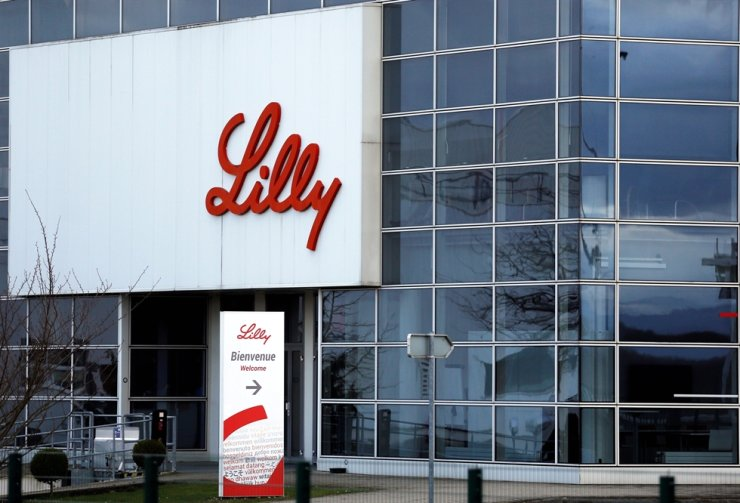 The logo of Lilly is seen on a wall of the Lilly France company unit, part of the Eli Lilly and Co pharmaceuticals group, in Fegersheim, near Strasbourg, France, February 1, 2018. REUTERS/Vincent Kessler