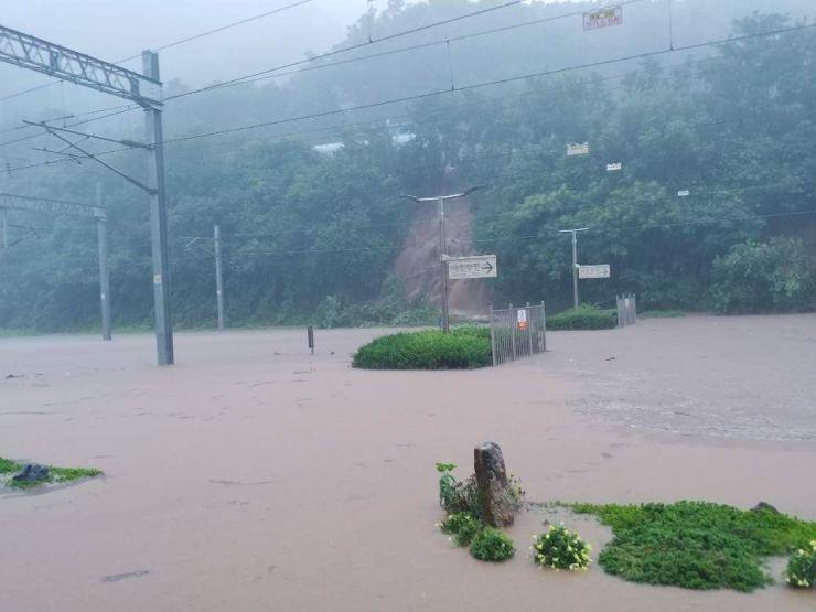 Train tracks near Samtan Station on the Chungbuk Line are submerged due to heavy rain, Sunday. / Yonhap