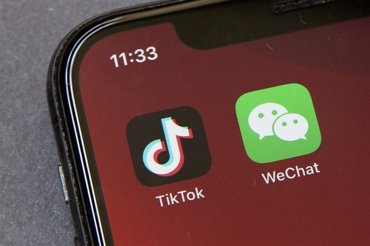 Icons for the smartphone apps TikTok and WeChat are seen on a smartphone screen in Beijing, Friday, Aug. 7, 2020. U.S. President Donald Trump has ordered a sweeping but unspecified ban on dealings with the Chinese owners of the consumer apps TikTok and WeChat, although it remains unclear if he has the legal authority to actually ban the apps from the U.S. AP