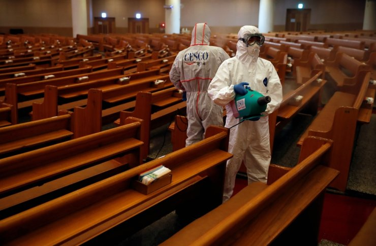 Members of a disinfection company sanitise the Yoido Full Gospel Church, which is the largest church in the country, in Seoul, Aug. 21, 2020. Reuters